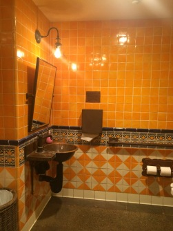 Bathroom with vibrant Mexican tile