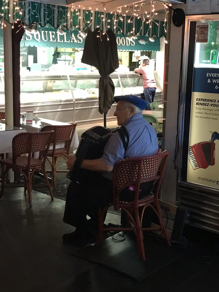 Monsieur Marcel restaurant accordion player
